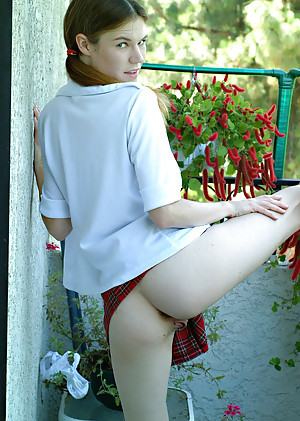 Prexy teen Melissa is posing around her lovable schoolgirl uniform