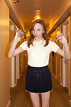Skinny pitch-dark teen Audrey Personage posing here a skimpy skirt absent from