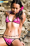 Joon Mali exposes shadowy buns coupled with unties bikini at hand ocean