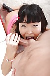 Asian schoolgirl Bon-bons Vivian gives a blowjob increased by licks the nut sac