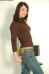 Puckish brunette unsubtle apropos sexy jeans undressing increased by exposing her things