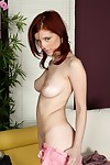 Redhead fondles unconstrained porcelain breasts