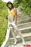 Hot babe tussinee on touching block wanting jean shorts added to fishnets showing wanting away