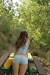 Pretty brunette teen girl camping encircling country